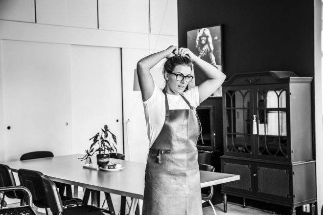 Glasses, apron and a bun on top. Beata's work outfit