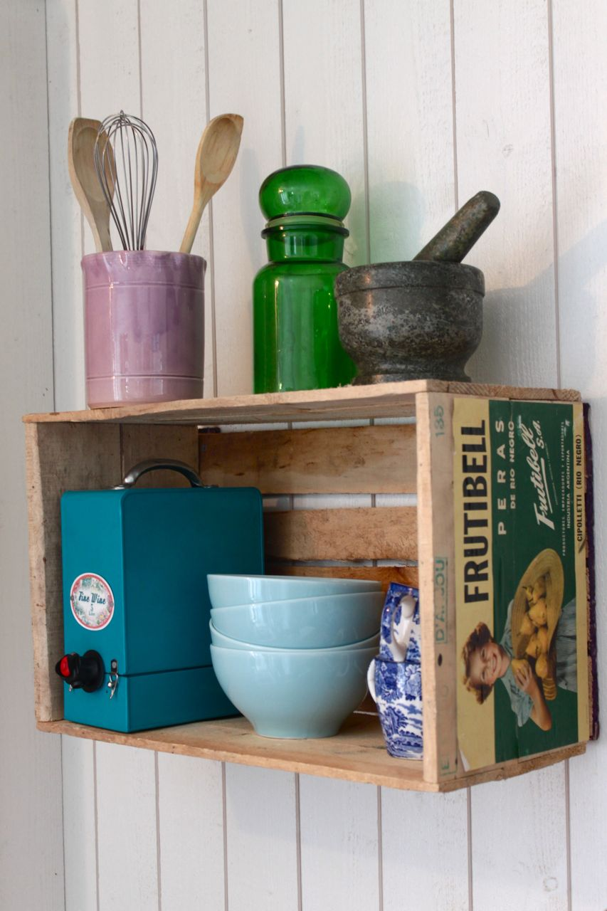 Nesting wooden crates as shelves dos family